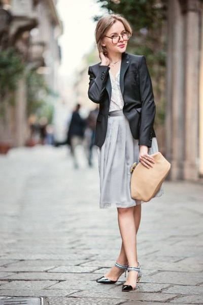black leather blazer and gray pleated midi skirt