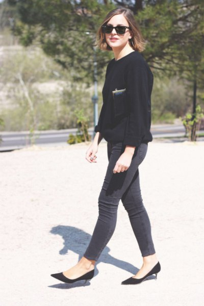 black sweater and slim jeans