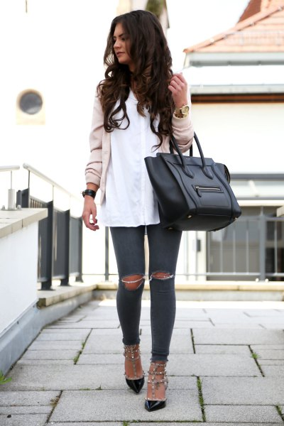 light pink bomber jacket with white shirt and black cat heels