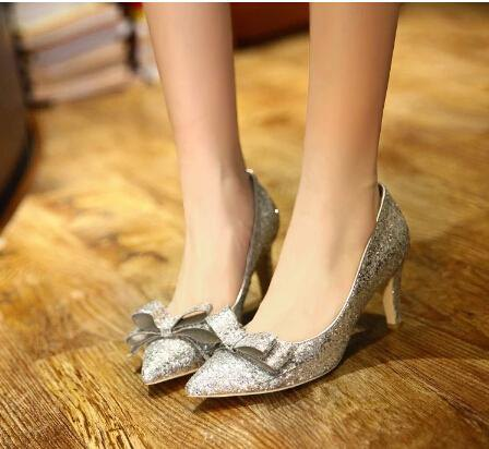 cat heels in silver band with black shift mini dress