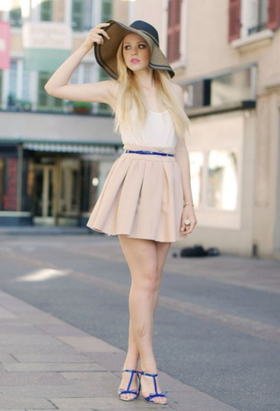 white vest top and light pink mini pleated skirt
