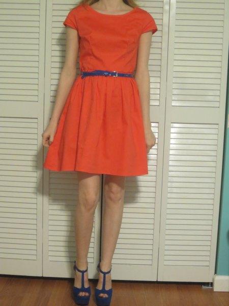 orange cap sleeve mini skater dress with blue slim leather belt