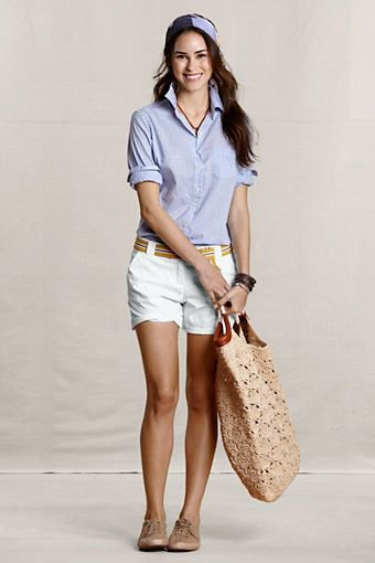blue linen shirt with white chino shorts