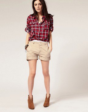red and white checkered boyfriend shirt with beige cuffed shorts
