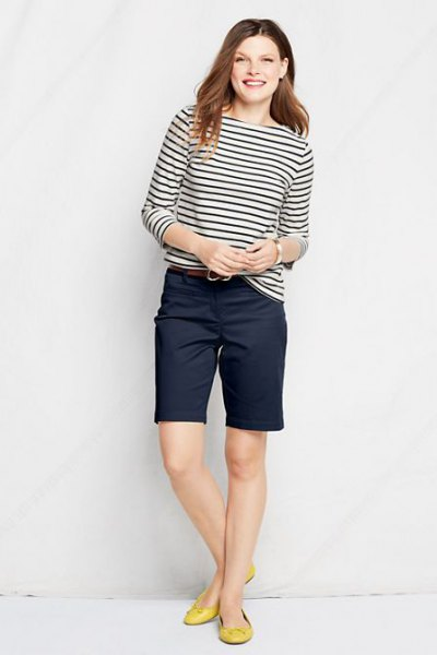 black and white striped long sleeve tee with navy blue knee length chino shorts