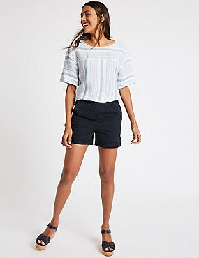 white and light blue tee with navy blue shorts