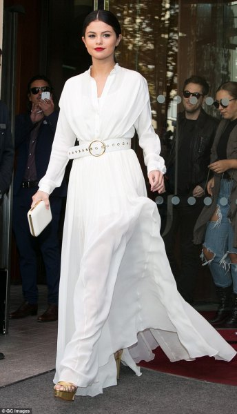 white long-sleeved flared dress with matching belt