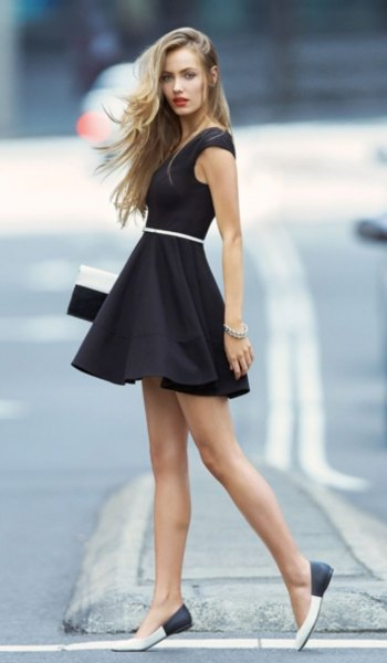 black sleeveless mini-skater dress with white slim belt