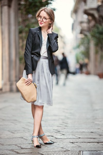 black blazer with gray pleated dress and black ankle strap kitten heels shoes