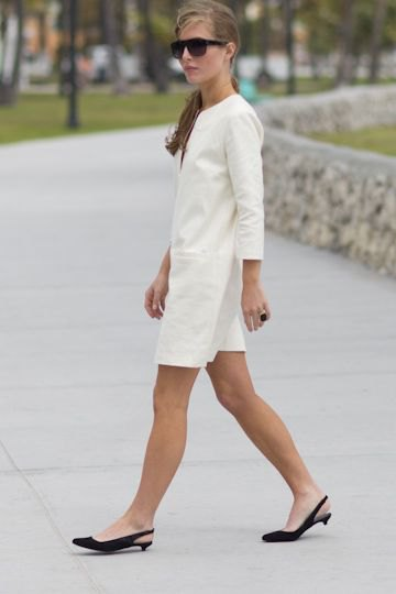 white long sleeve mini-shirt dress with black kitten heels shoes