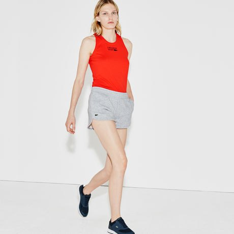 red vest top with gray fleece jogging shorts