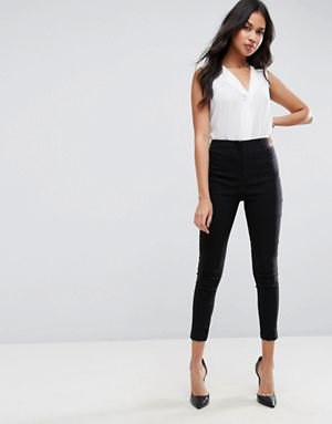white v-neck sleeveless blouse with black skinny fit cropped pants