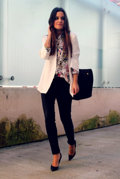 white blazer with printed silk blouse and black chinos