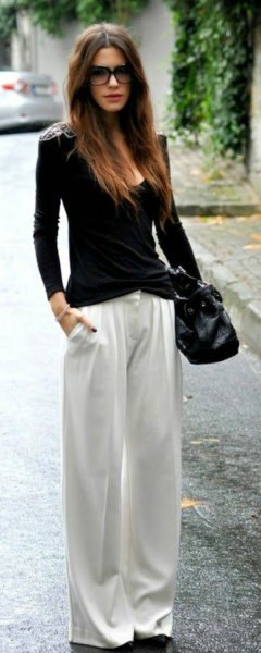 black matching bucket neck sweater with white pants