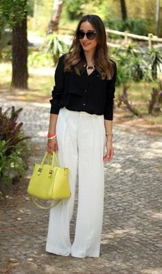 black button up shirt with white pants and lemon yellow leather bag