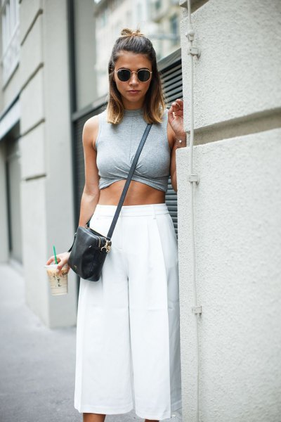 gray sleeveless crop top with white cropped trousers
