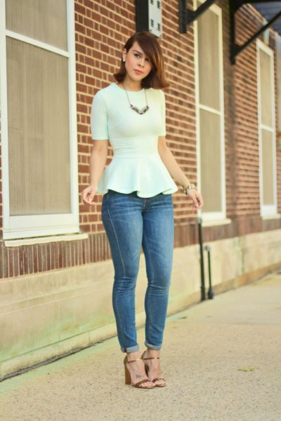 white peplum shape matching blouse with blue cuffed skinny jeans