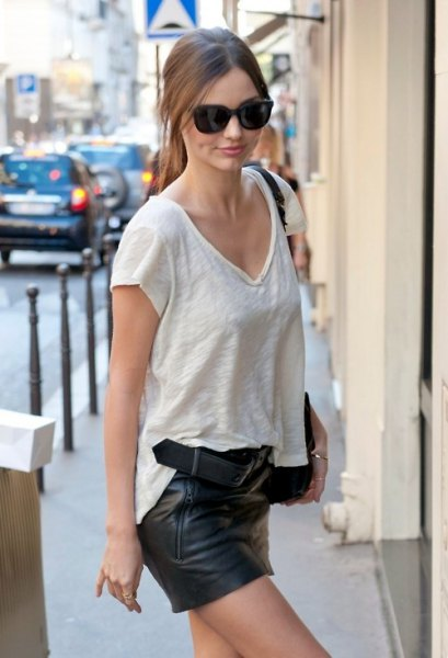 white v-neck structure with black mini leather shorts