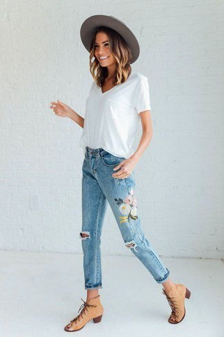 white v-neck shirt with floral embroidered cropped jeans