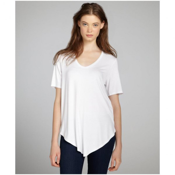 white asymmetrical t-shirt with black skinny jeans