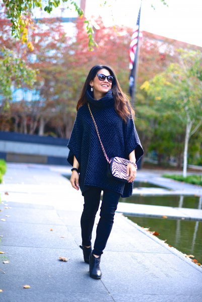 navy blue poncho sweater with black skinny jeans