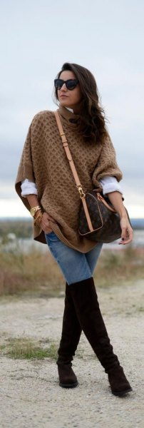 green knitted poncho shirt with black thigh high boots