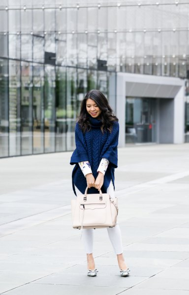 navy blue knitted poncho shirt with white skinny jeans