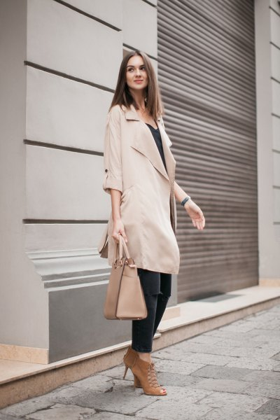 beige half-heated long trench coat with black vest top