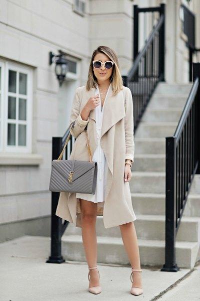 beige midi jacket with white mini shirt dress
