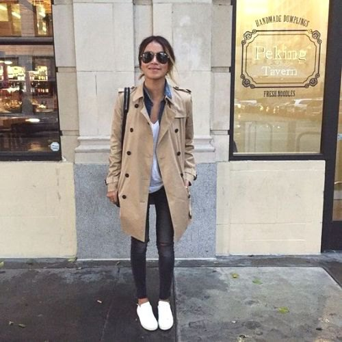 beige trench coat with chambray shirt and gray jeans