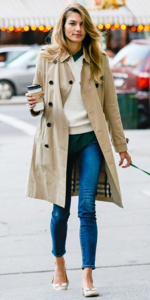 long trench coat with white sweater and jeans