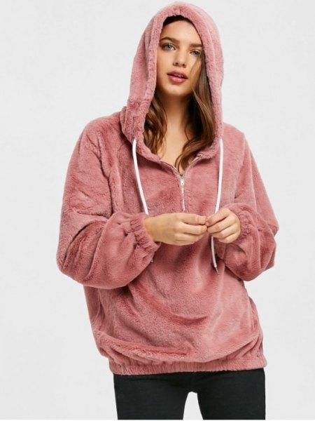 pink half-zip hoodie with black skinny jeans