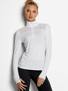 white half zip with black skinny jeans