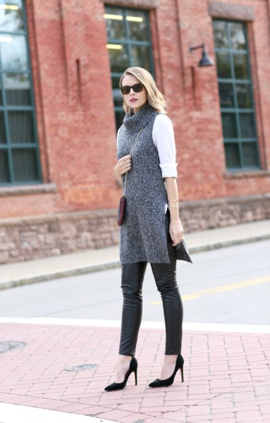 white blouse with gray turtleneck tunic sweater and leather leggings