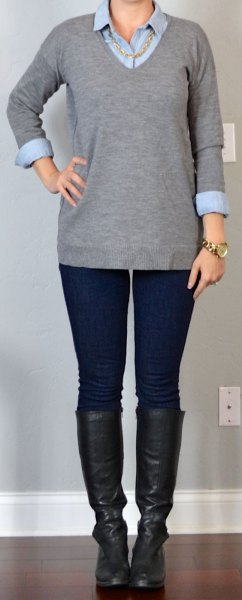 gray v-neck sweater with black leather in knee-high shoes