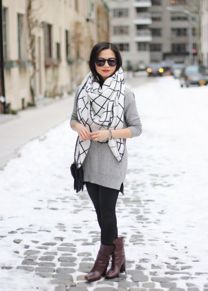 gray sweater with white and black checkered scarf