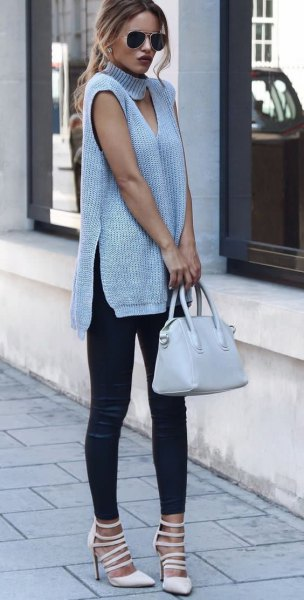 gray sleeveless cut-out tunic dress with turtleneck at the front with boots