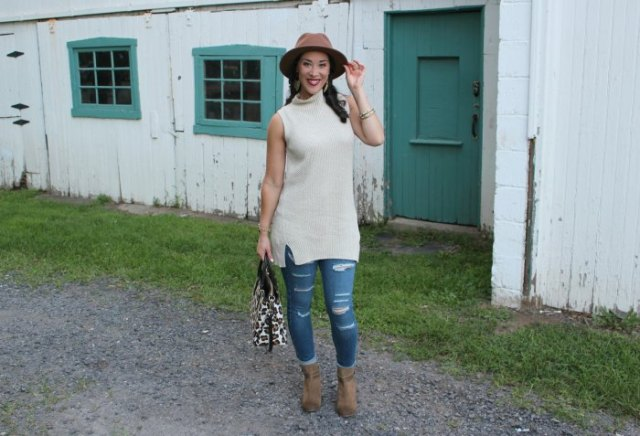 white sleeveless suede ribbed tunic sweater with brown hat