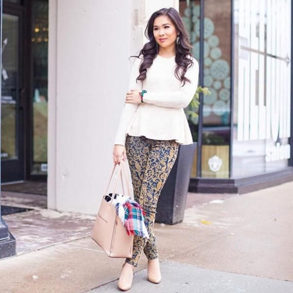 white peplum knitted sweater with pink and blue stem printed skinny pants