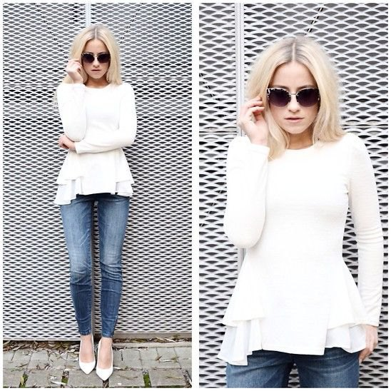 white peplum sweater with ruffled blouse and jeans