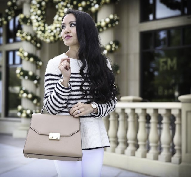 white and black striped sweater with pink leather bags