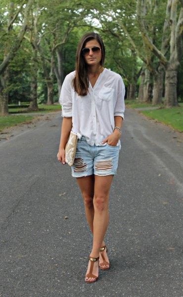 white oversized linen shirt with ripped denim shorts
