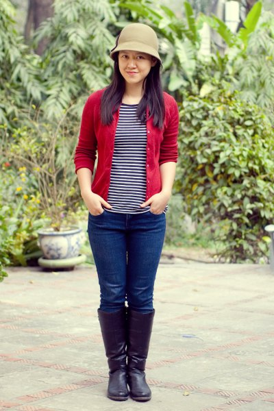 red cardigan with black and white striped tee and bucket hat