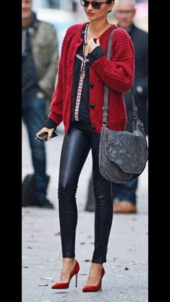 red cardigan with black leather pants