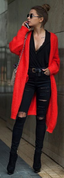 red midi cardigan with black deep v-neck blouse and ripped jeans