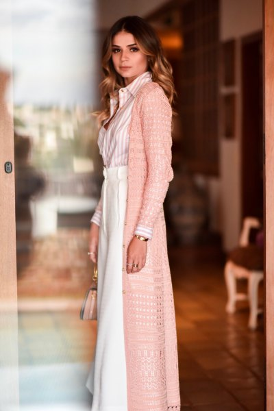 blush pink crocheted long cardigan with maxi white blown skirt