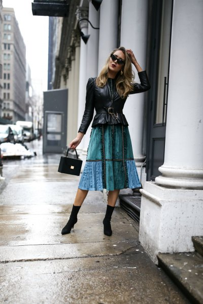 black peplum leather jacket with blue midi puffed skirt