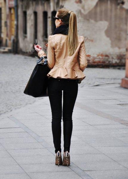 pink peplum jacket with black skinny jeans