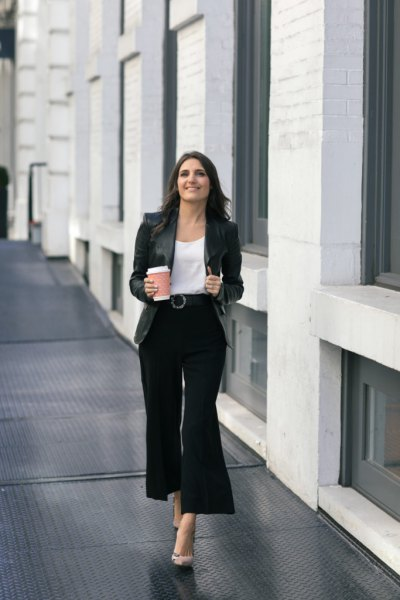 white scoop neck blouse and black wide leg trousers
