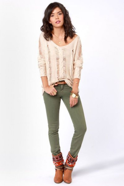 light pink ripped long sleeve top with olive skinny jeans